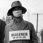Porter un masque en tissu contre la grippe espagnole en 1918